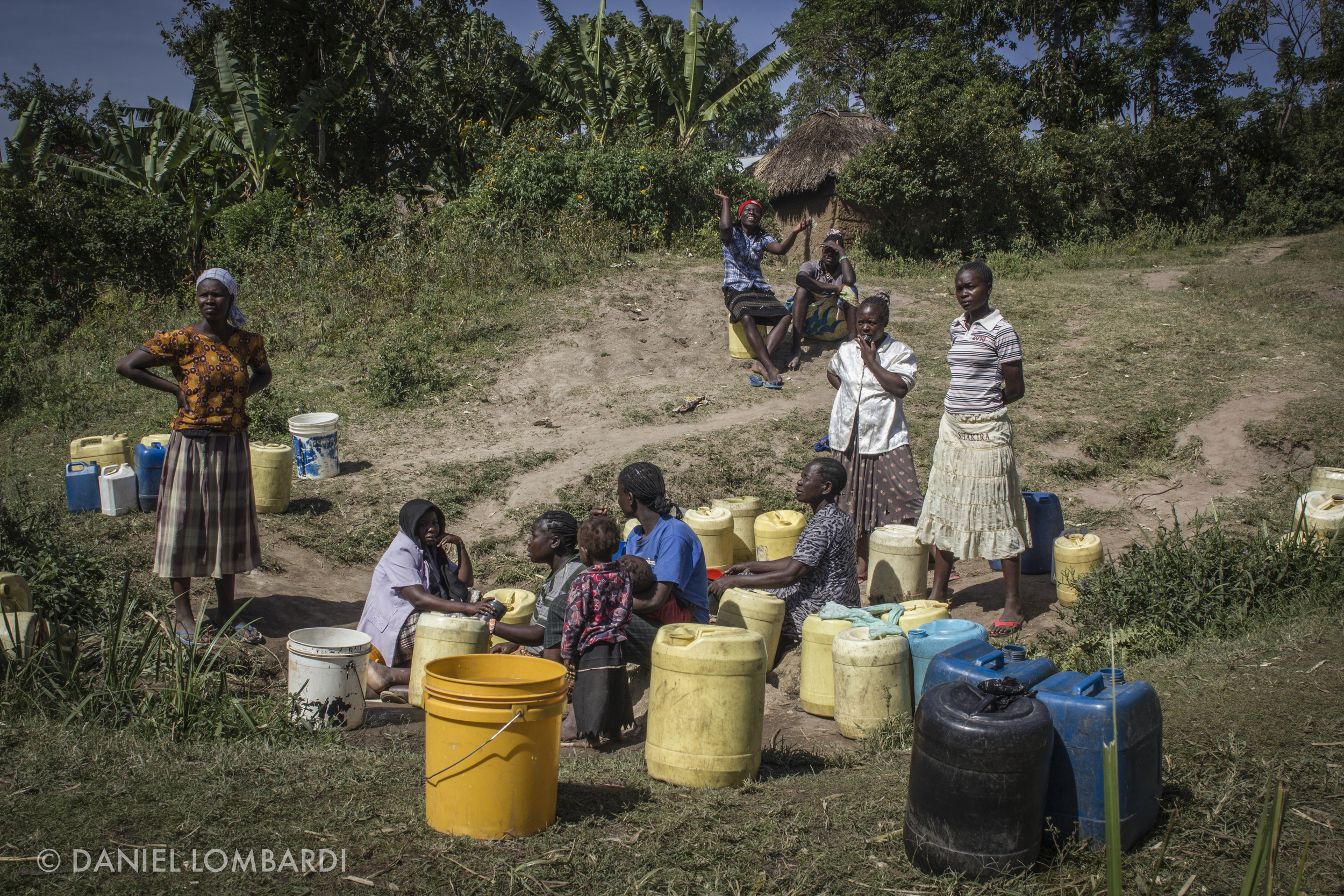 At this collection point tensions ran high as some people gathered water to make bricks to make money while other women gather water for cooking and drinking for their families.