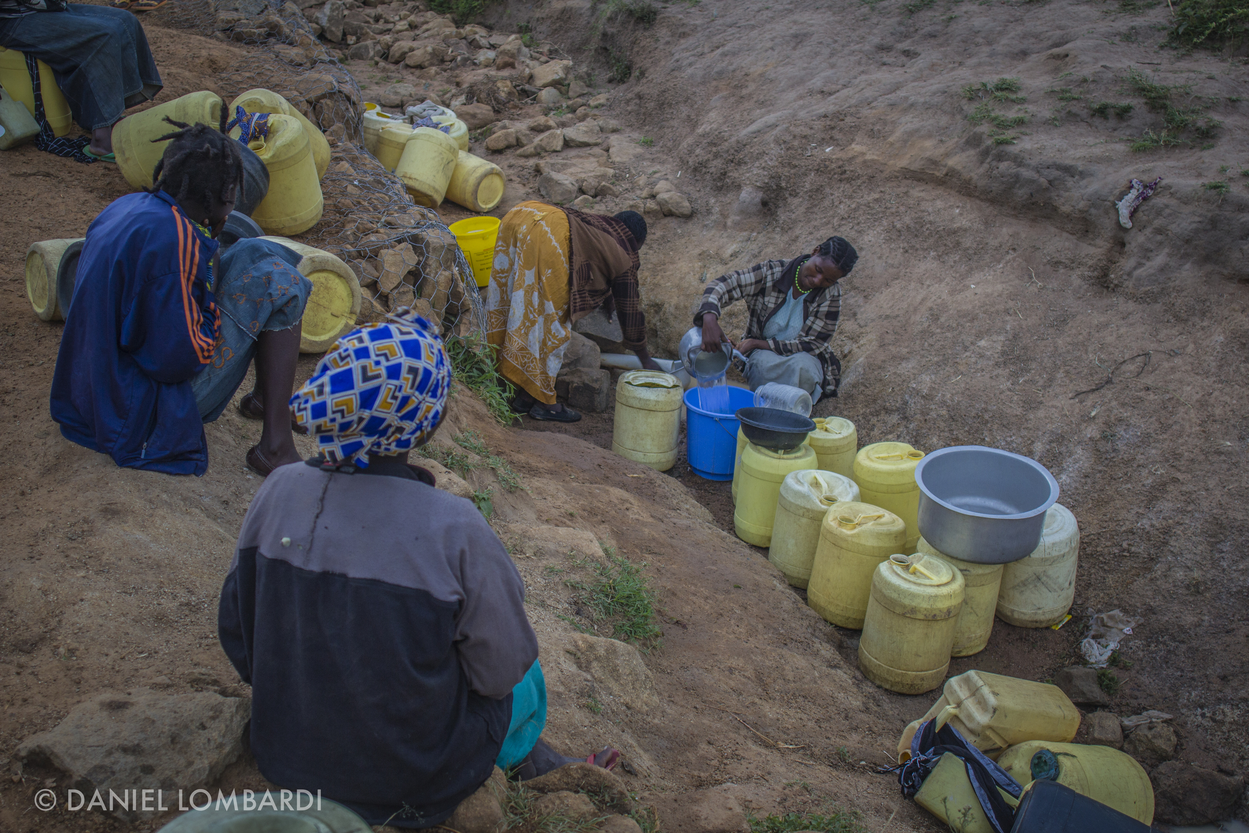 Some women bring half a dozen or more jerrycans to the water sources everyday. Carrying these jugs full of water is extremely time consuming not to mention very difficult.