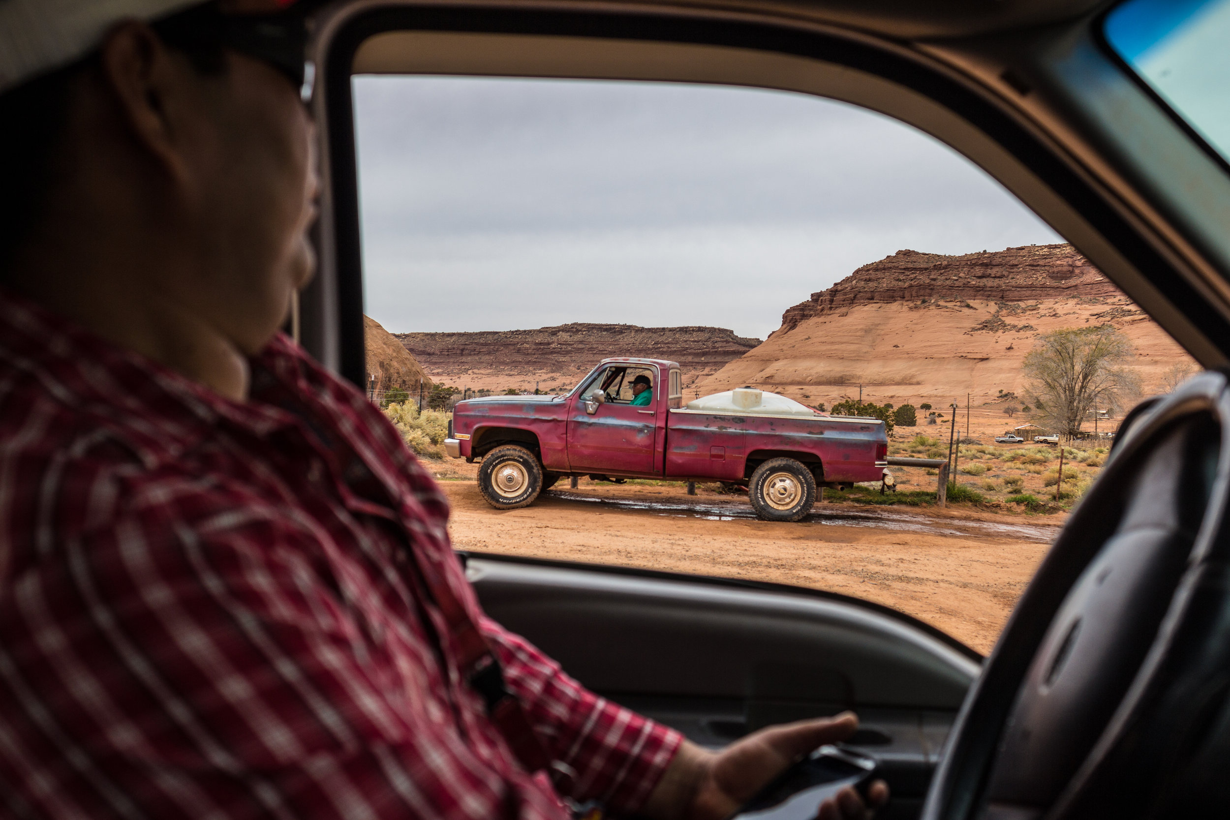 Will Yazzie waits in line with his truck to fill tanks with water near the community's center.   This is the only water access his family has and they must fill tanks and drive them back to their house on a regular basis.