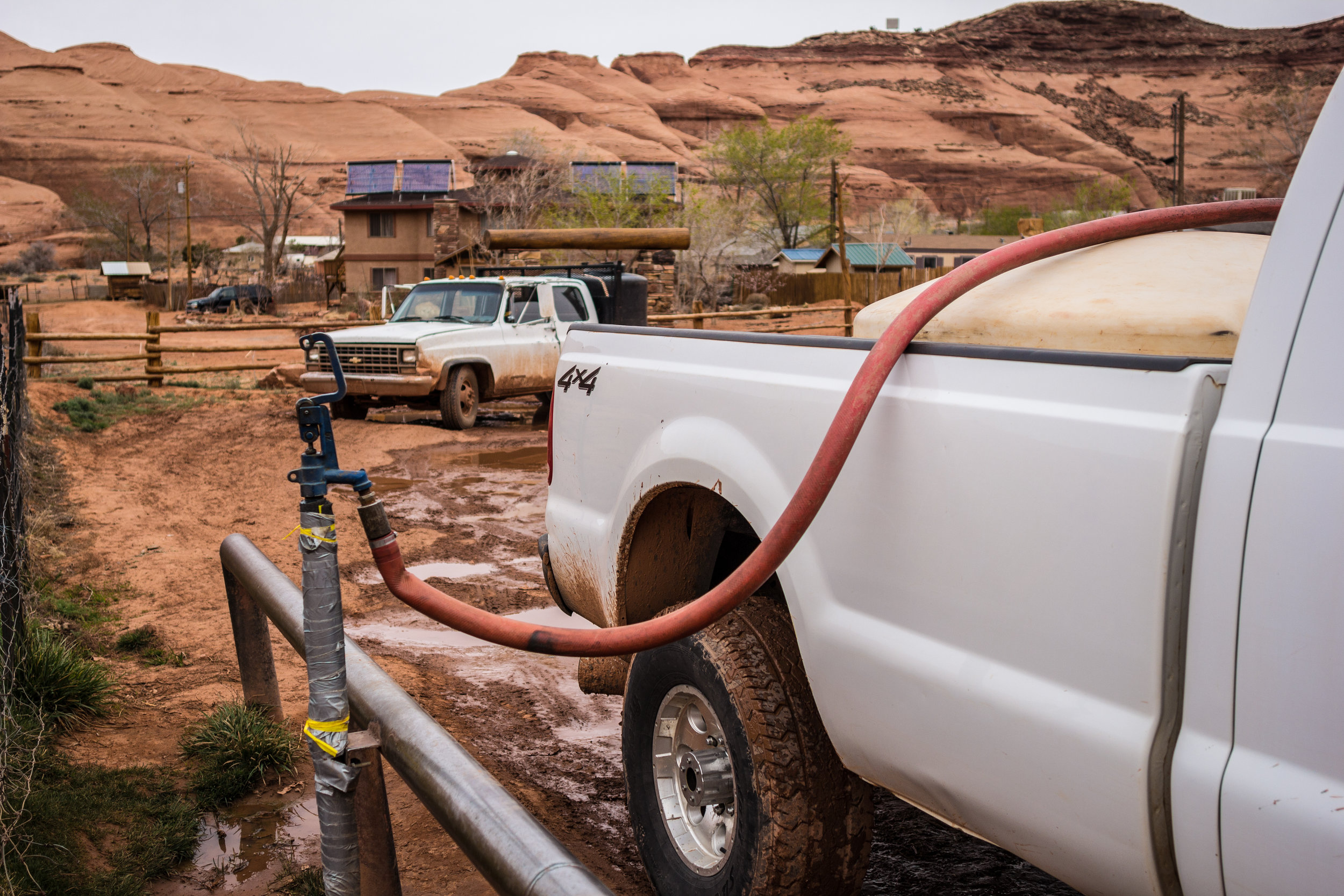 Will Yazzie's tank slowly fills in the back of his truck. This is the only way his family has access to clean drinking water. It takes about an hour each way to drive to the water tap at the center of the community and sometimes waiting for your turn in line can take even longer.