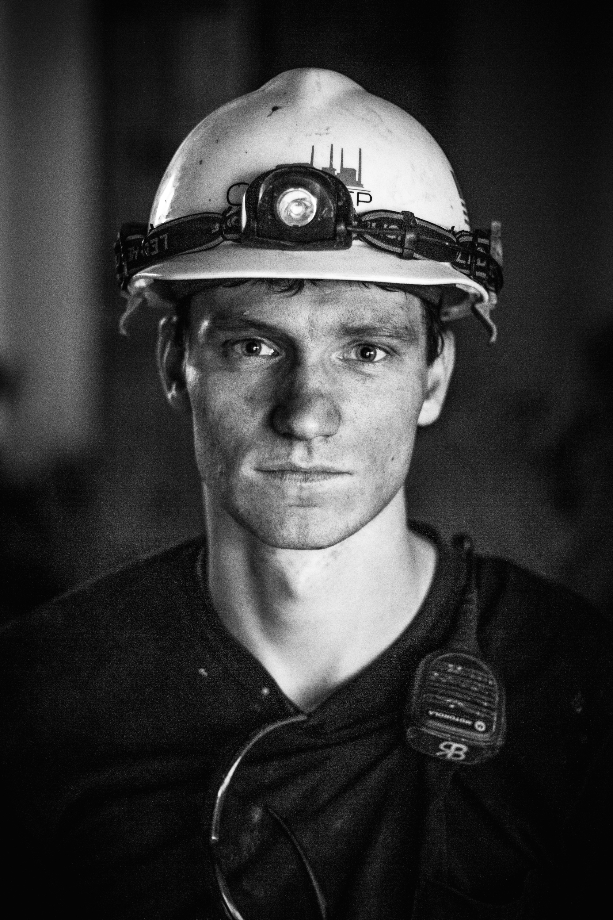 Working in the Coal fired power plant is a hot and dirty job but the pay is good. Ryan started out making $24 an hour with many opportunities for overtime. But he was the last employee to be hired and could be the first to be let go if the plant closes half of its units ahead of schedule. In the portraits below he poses for me and momentarily lets his tiresome night schedule pull his gaze into the distance.