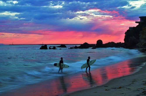 surfing wave sunset.jpg