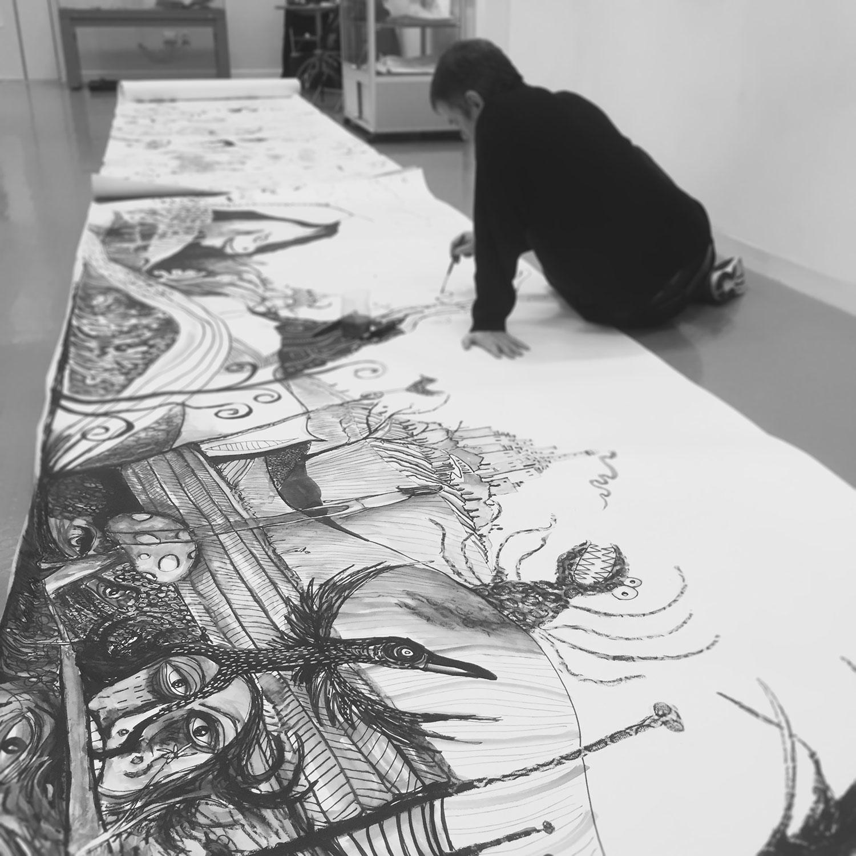 Matthew Watkins working on large scale collaborative drawing