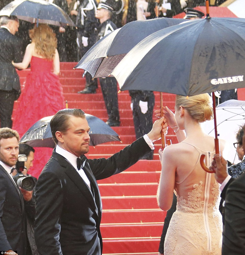 Rain drenched the red carpet prior to the Great Gatsby screening at Cannes in 2013. LuckyLeo had abranded umbrella on hand.