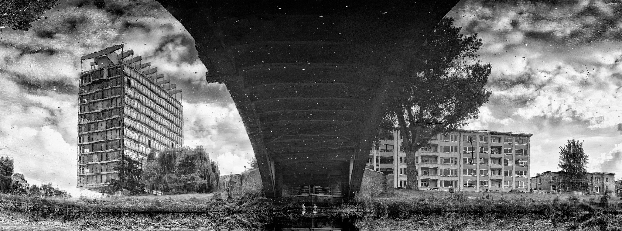 A reflection. Under the bridge, there's dirty water