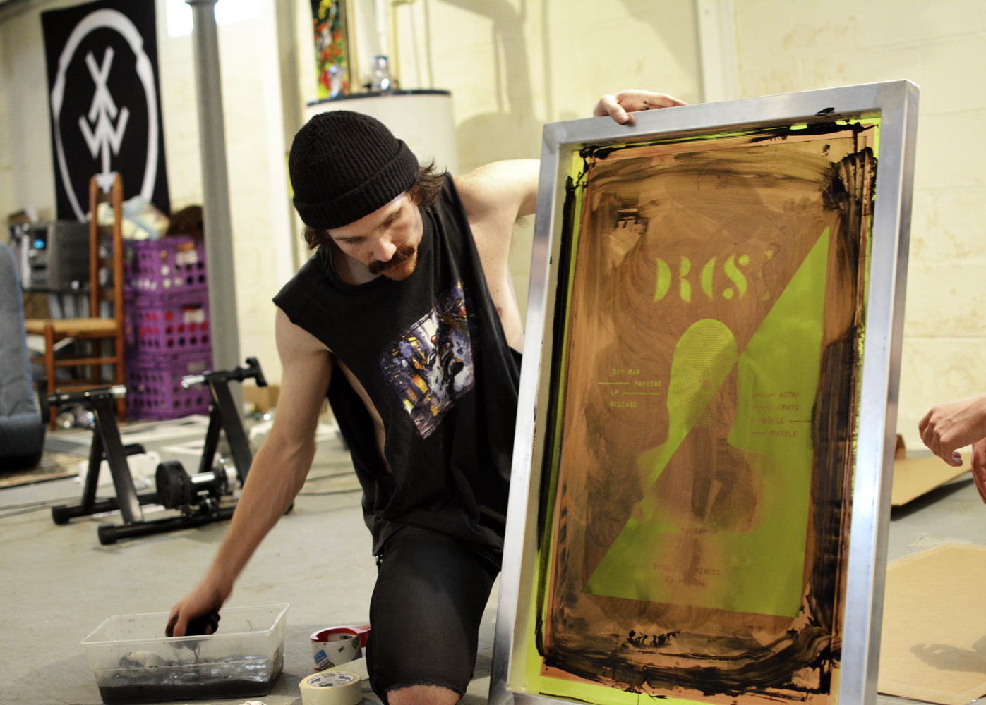 My best friend Jacob cleaning out the screen after we printed the posters.