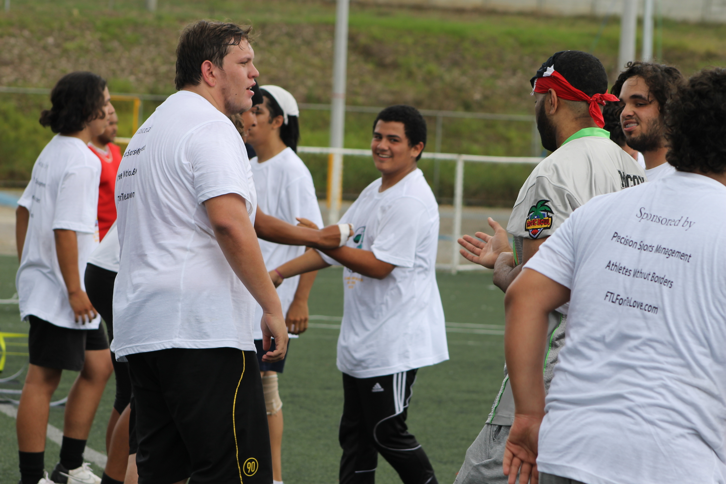Coach McCoy Giving His Defensive Lineman Some Pointers