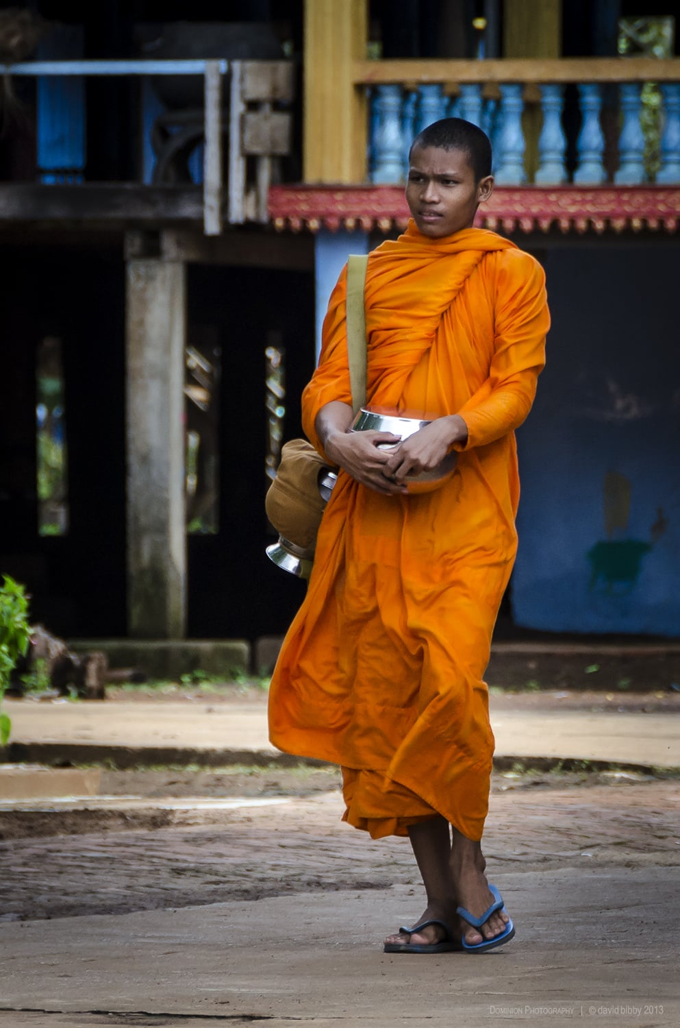 Young monk  - A Buddhist monk prepares for the morning alms round. Wat Hanchey, Cambodia.