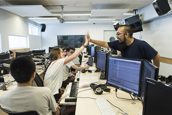 600x400-Faculty_Ben_Cantil_gives_a_student_a_high_five_in_his_Ableton_Live_class.png