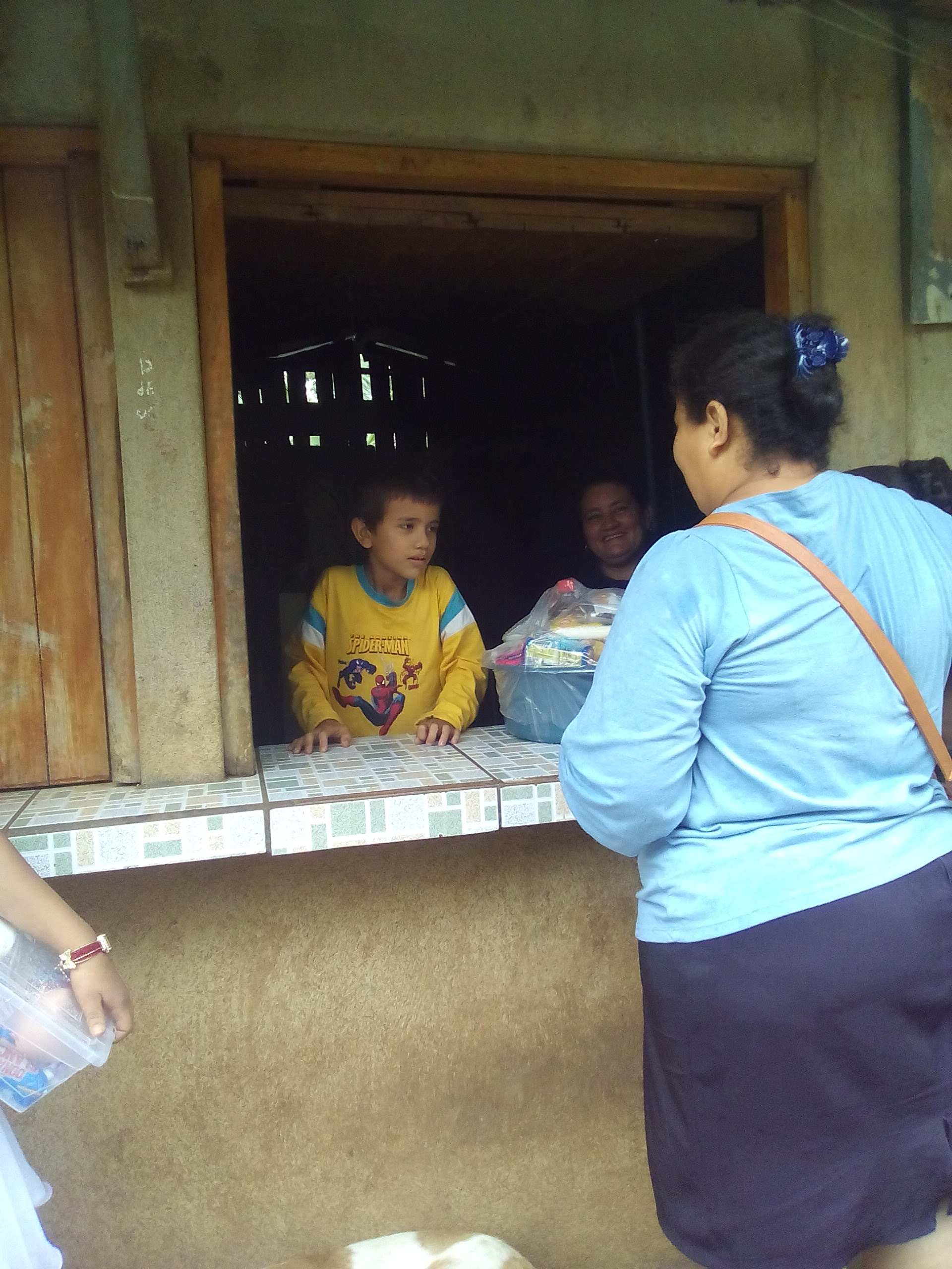 - Gabriela delivering to Jamilet's house