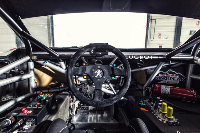 Peugeot 208 T16 Pikes Peak Interior Seb Loeb Cockpit.jpg
