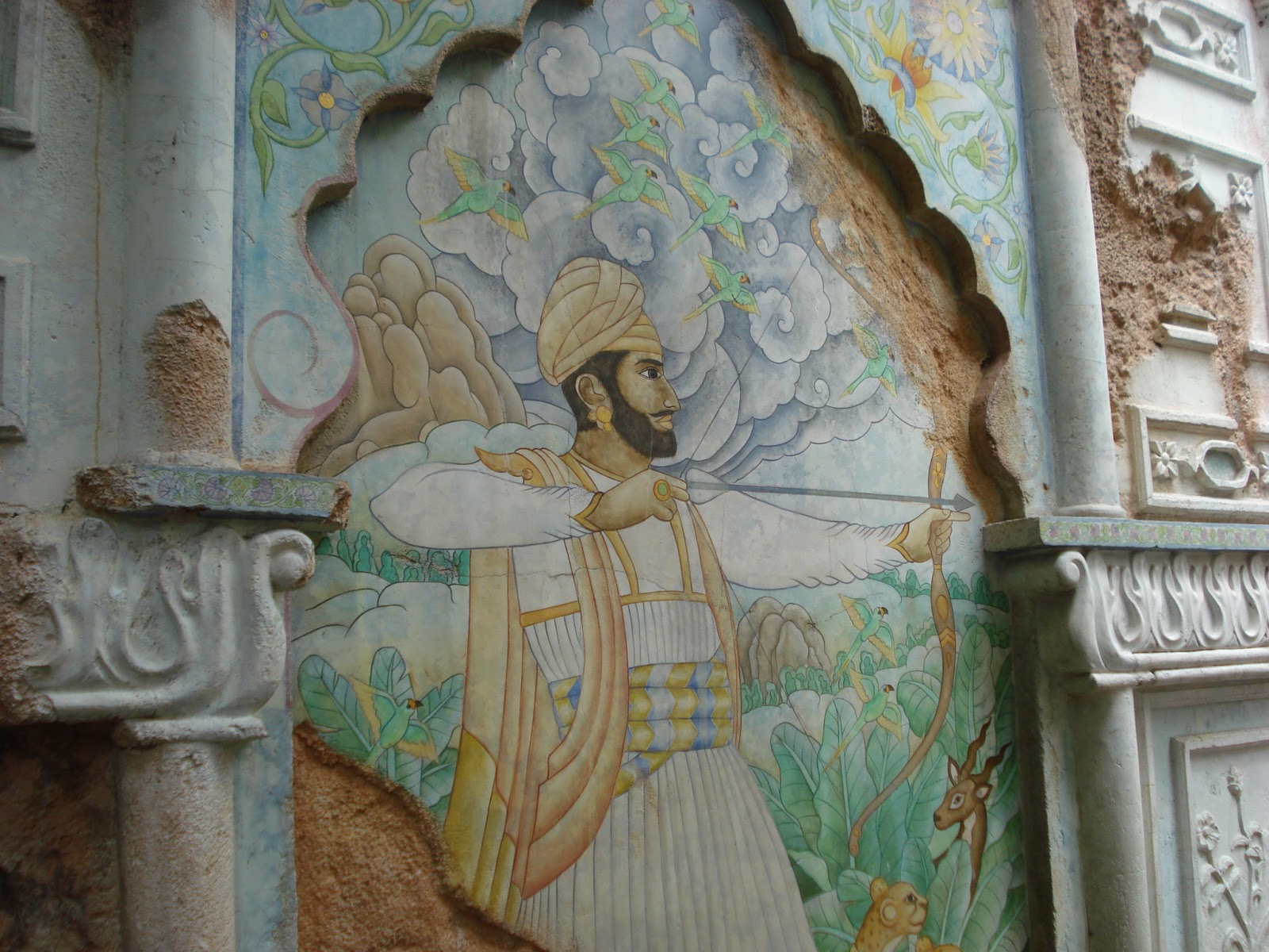 There are 2 Hidden Mickeys in this mural on the Maharajah Jungle Trek in Animal Kingdom.