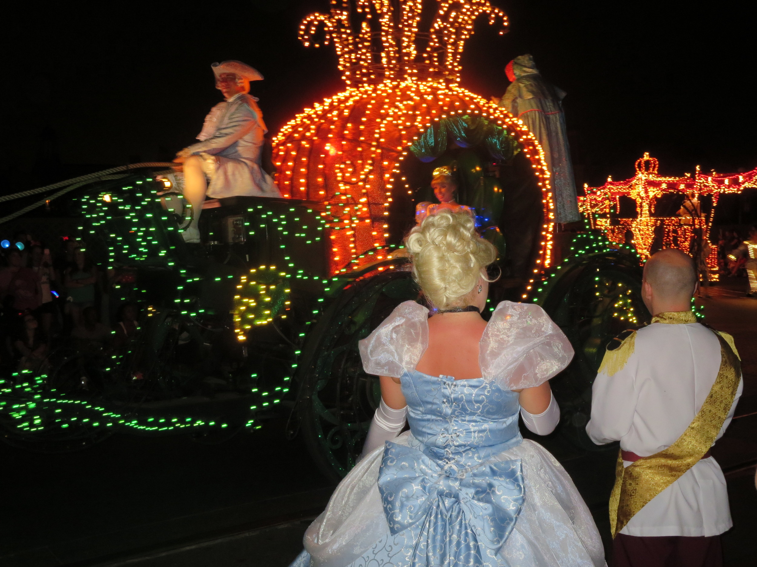 Cinderella in the Electrical Light Parade with guests showing their Disney Side