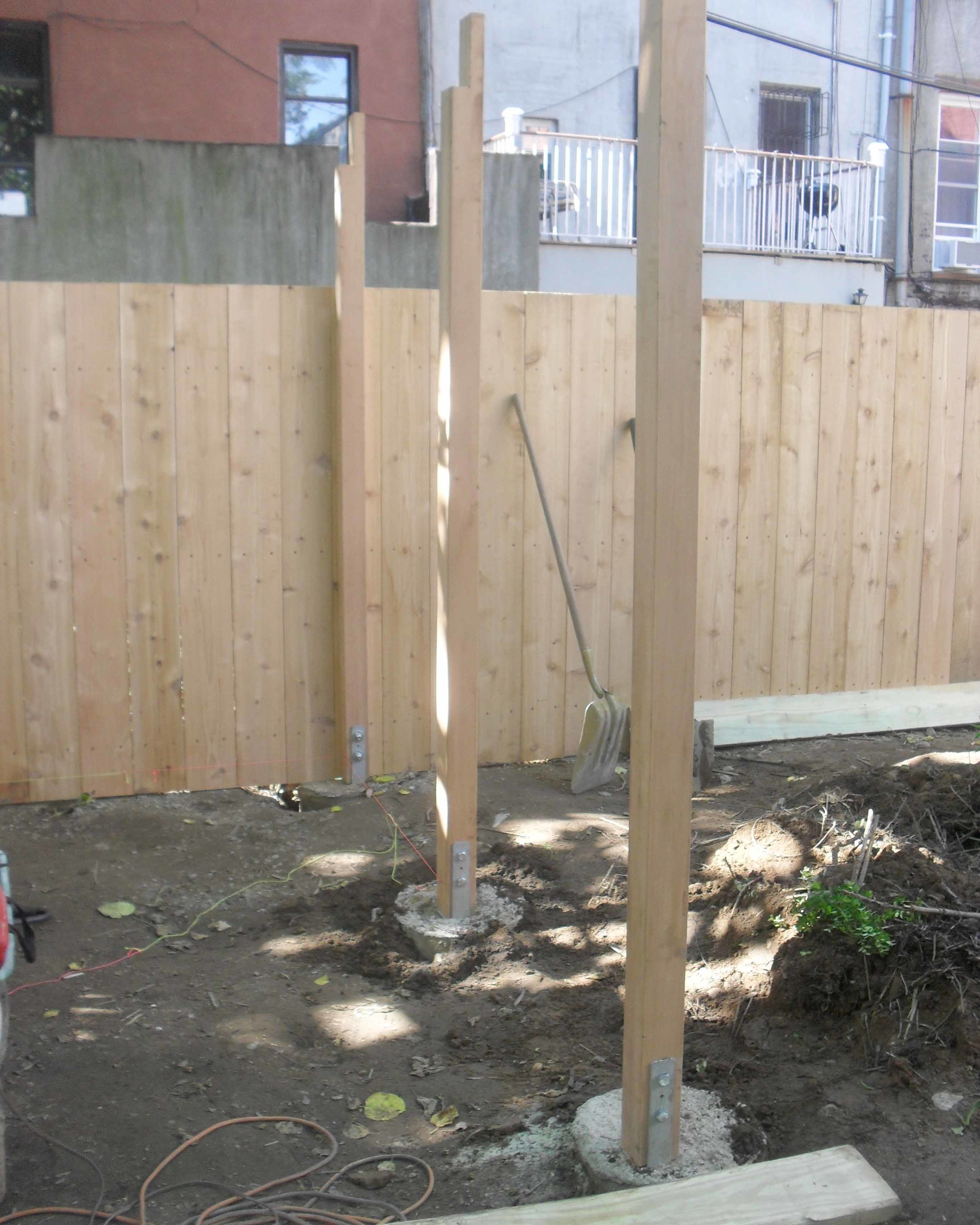 FOOTINGS + SIMPSON CONNECTION + 4X4 CEDAR POSTS