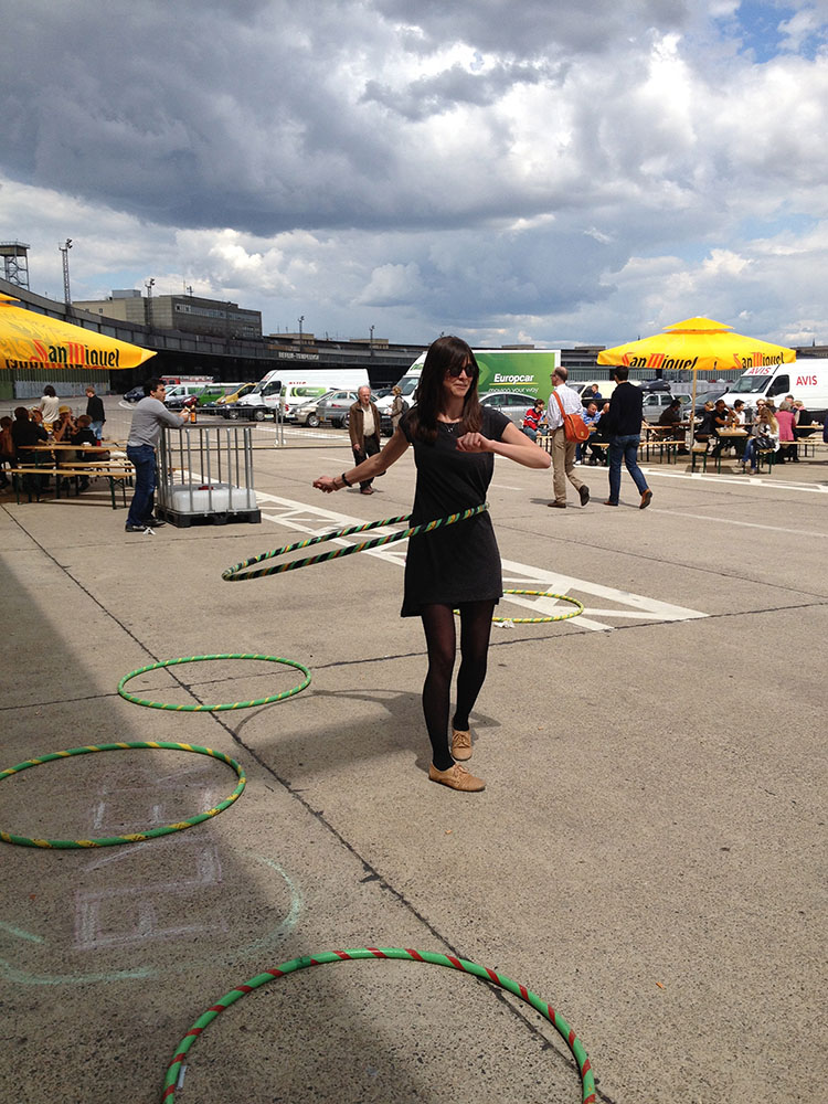 A spot of unexpected hula hooping at the DMY design festival, Tempelhof airport.