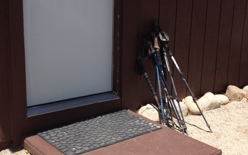 Hiker poles at rest outside a cabin at the Base Camp