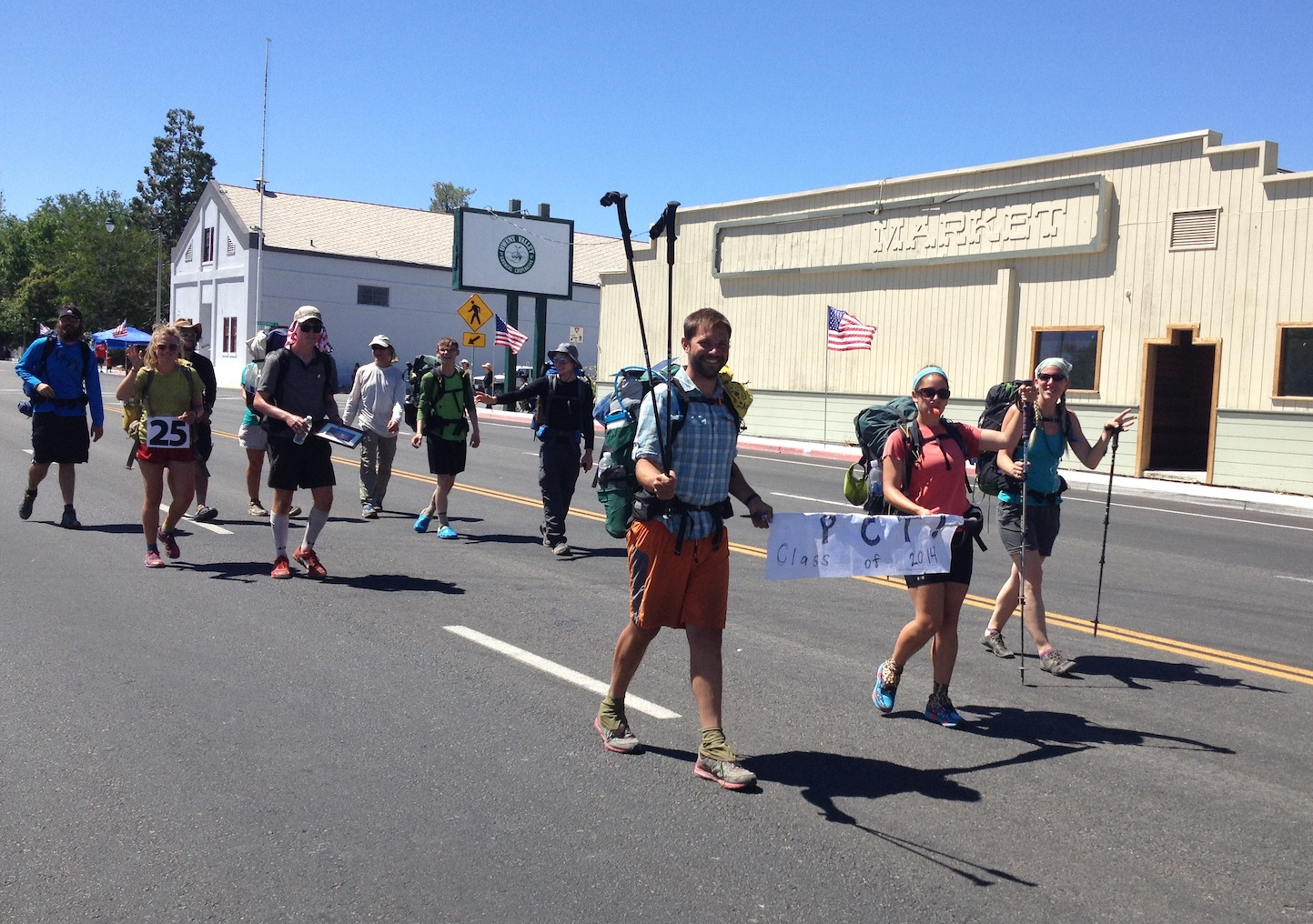 PCT hikers marching in the 4th of July Parade in Independence
