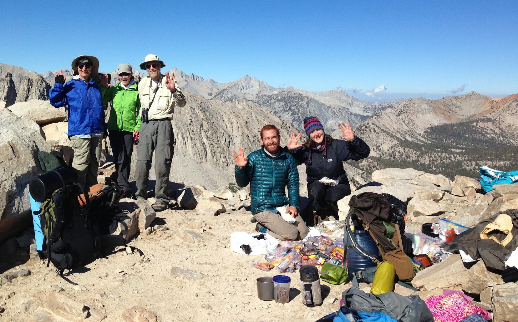 Sierra Nevada Bighorn Sheep Foundation board members Ginnie, Julie and John at Kearsarge Pass with happy JMT hikers Adam and friend on July 21.