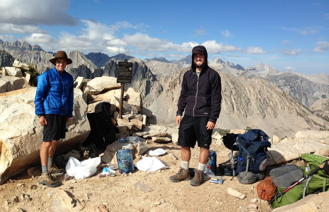 JMT hikers James and Sean at Kearsarge Pass during stormy July weather -- not stop is Mt. Whitney