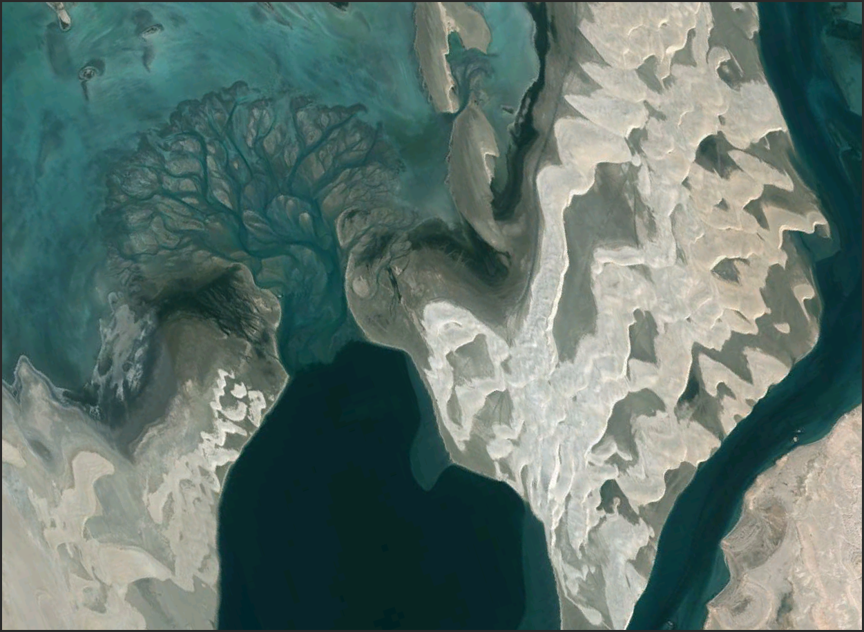 The most pathological geomorphology that I could find near Bahrain...some dunes, a subaqueous fan, a beach or two. A topographically limited area.   http://goo.gl/maps/ac3u