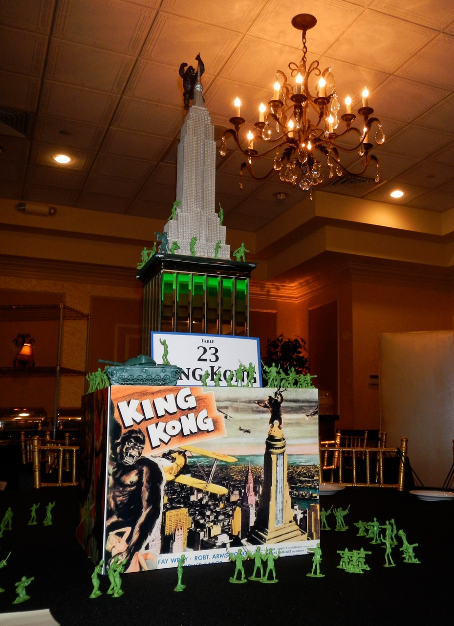 A King Kong centerpiece includes an Empire State Building statue, mirror cube, King Kong images, and an army of toy soldiers.
