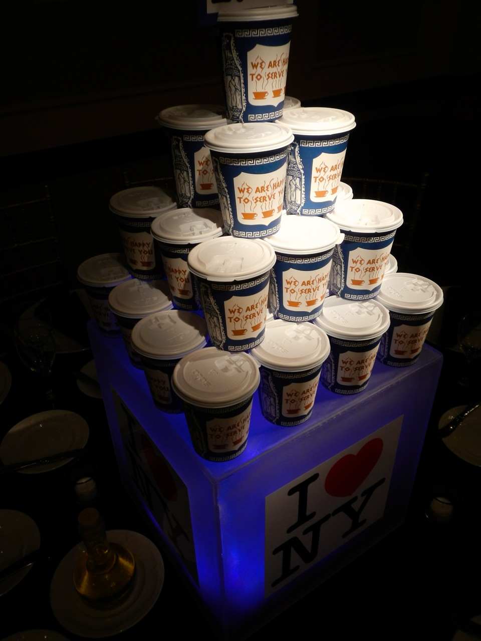 These famous coffee cups are all but extinct now in NYC, but we found them and built a tower of them. We also illuminated one of our cube foundations with blue LEDs and added images.