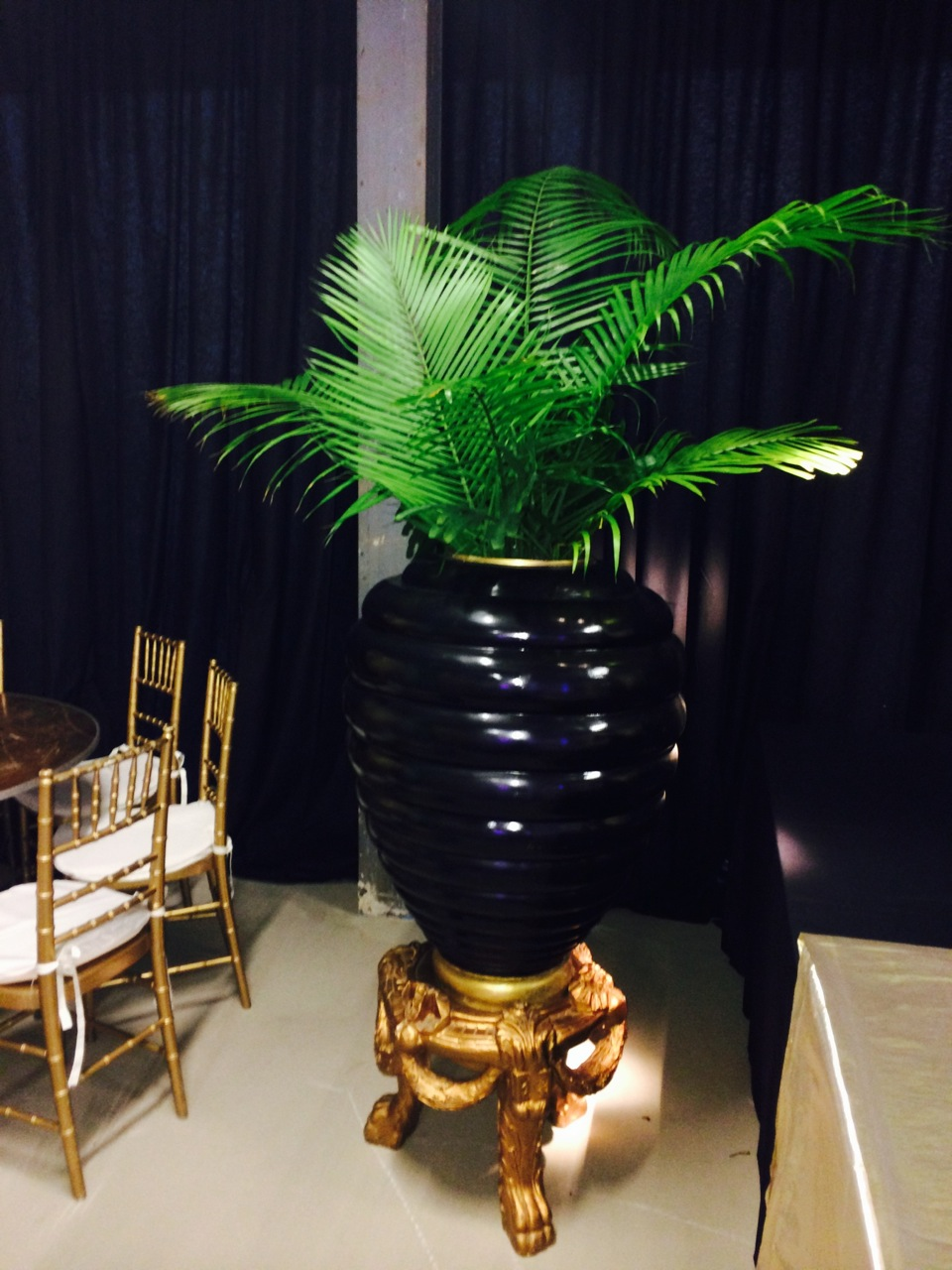 Our art deco beehive urns with gold lion's paw pedestals, paired with fresh majesty palm fronds