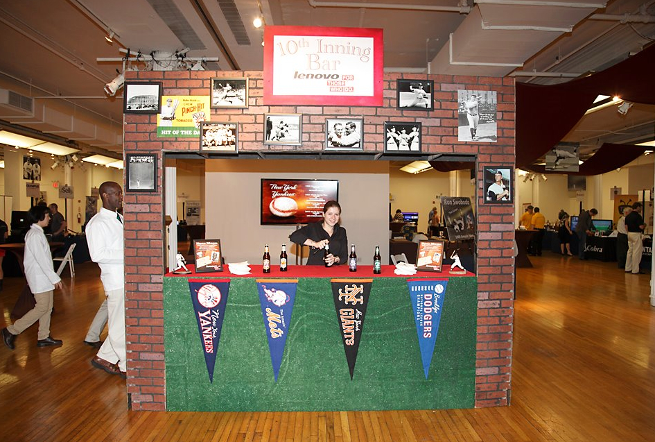 Eggsotic created a brick bar surround with custom signage and an astroturf bar front.
