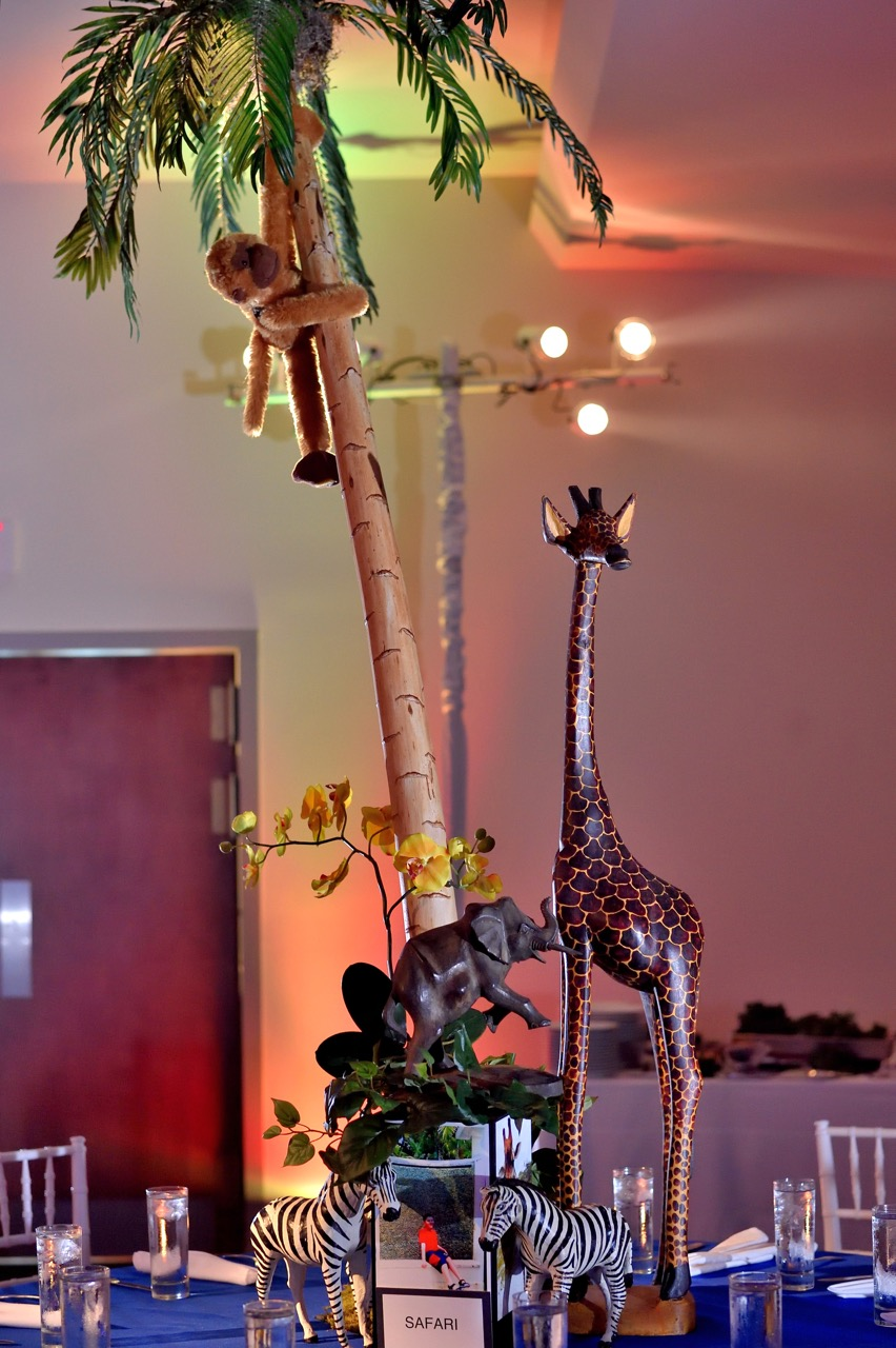 The family had recently taken a safari trip, so we gathered our safari animals to represent their vacation experience.