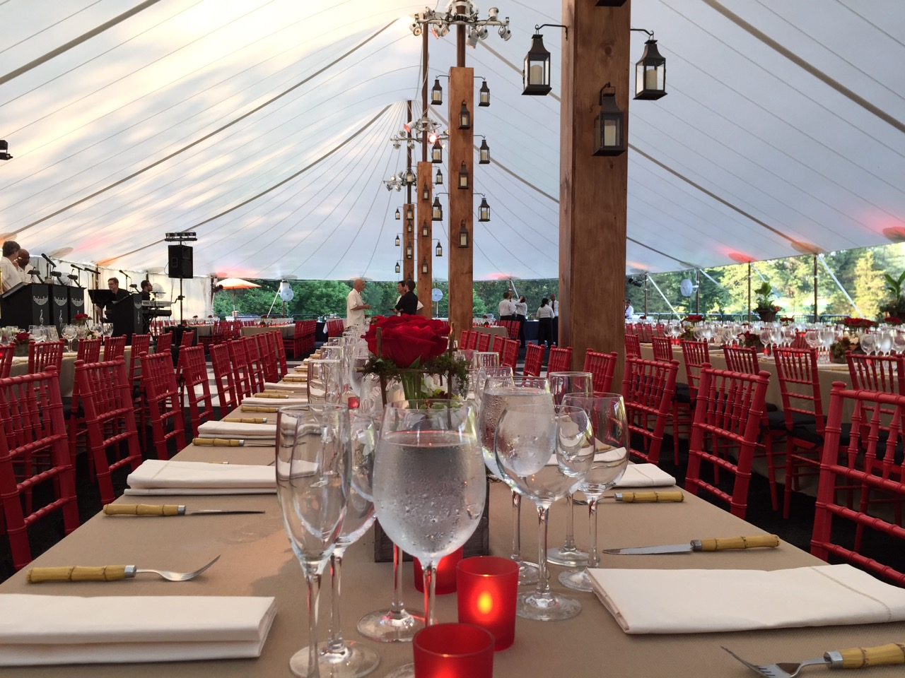 Custom tent pole surrounds with metal and glass lanterns