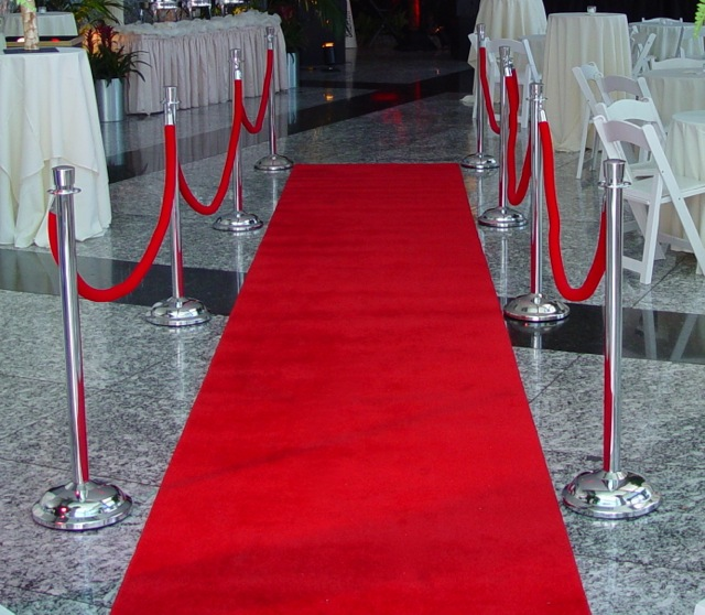 25' long x 4' wide red carpet with chrome stanchions and red velvet ropes