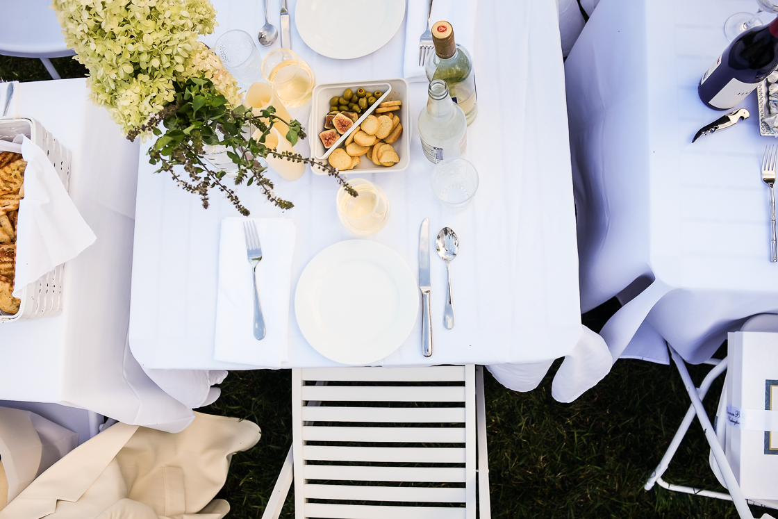 Charcuterie, white wine and ornate flower arrangements were popular picks at many tables for Diner En Blanc.