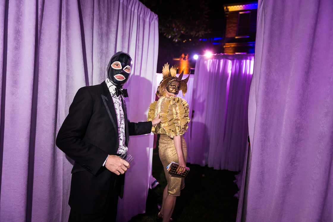 Guests Tim and Dana Rooney try to find their way out of the maze at the annual Night Nouveau benefit party at the historic Halcyon House in Georgetown.