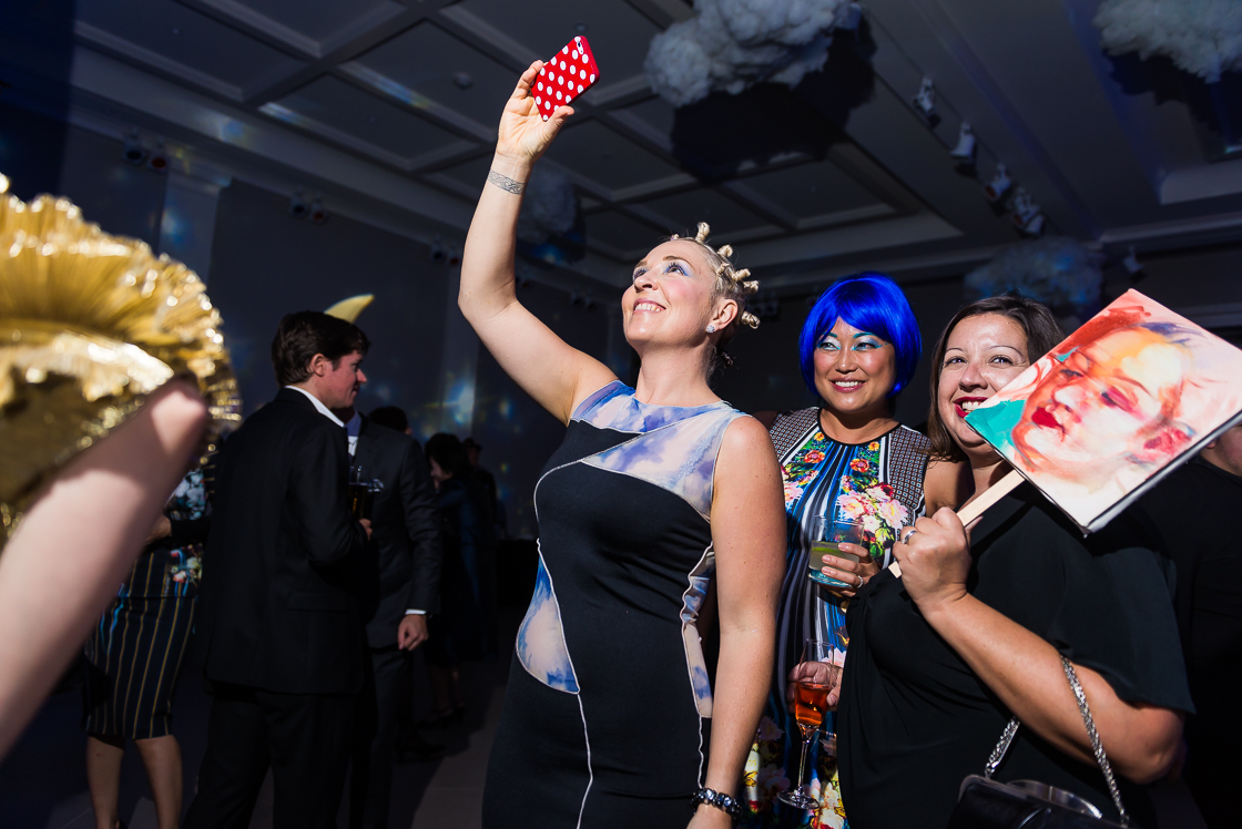It's not a themed party without someone dressed as Miley Cyrus - Kate Damon did the honors at the surrealist Night Nouveau benefit, as Grace Koh and Victoria Reis of Transformer Gallery looked on. Reis' look was all black, with a portrait of herself as a mask.