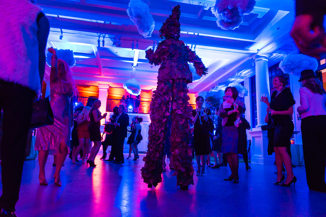 Guests at the surrealism-themed Night Nouveau party danced the night away amid dramatic performance artists, like this leafy dancer on stilts.