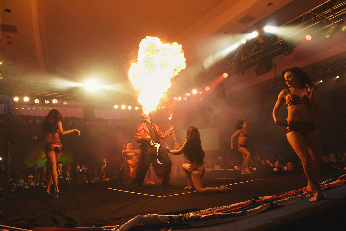 Pre-dinner live entertainment included a male fire eater with female dancers, and a pair of acrobats at the annual Fight Night benefit.