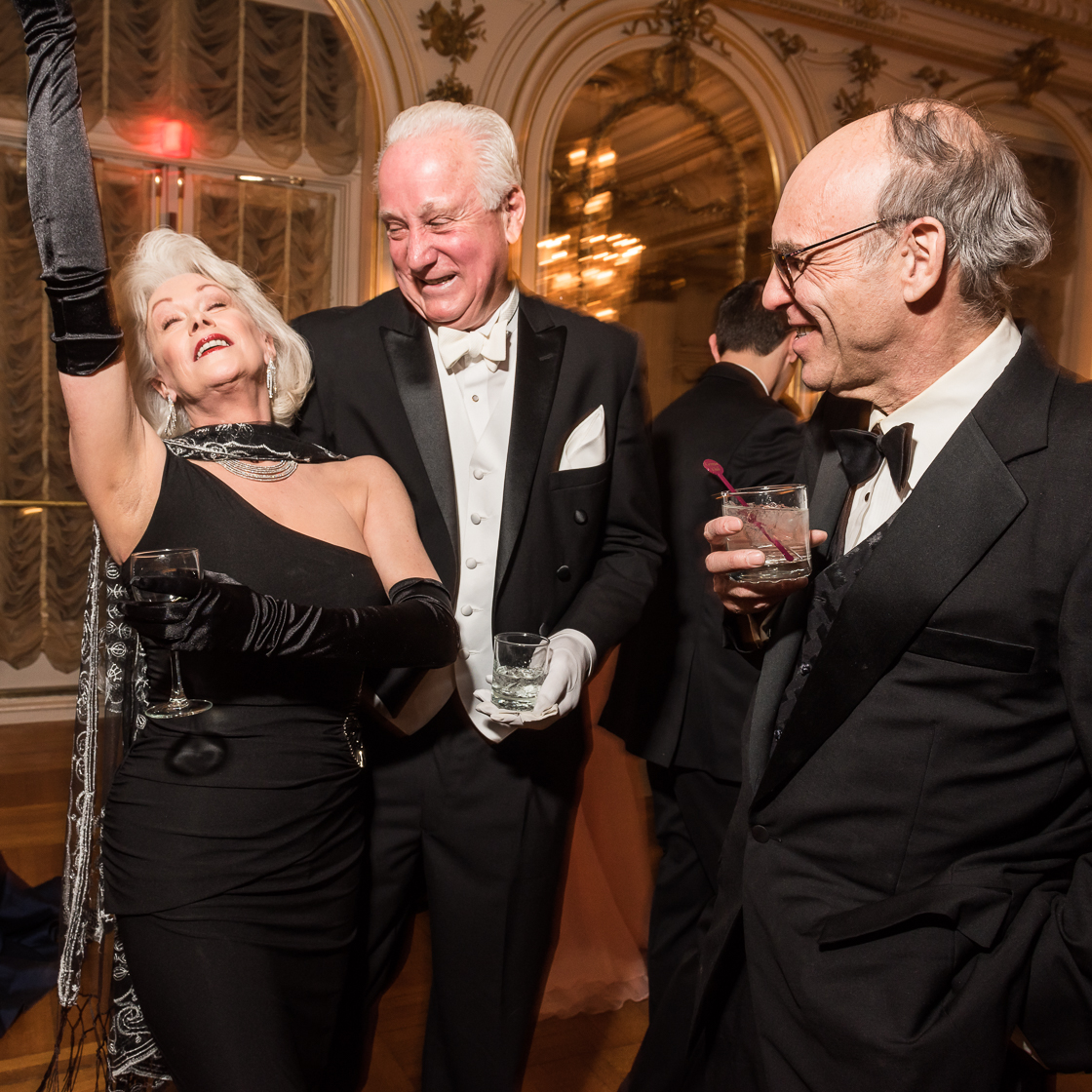 Retired society writer Robin Phillips shows off her fabulous side as Timothy Thomas and scientist Andrew Sostek look on.