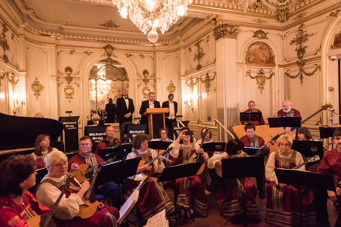 Flanked by the Washington  Balalaika Society, event chairman Paul du Quenoy welcomes guests to the annual Russian Ball with Prince Dimitri Obolensky (left) and Prince Nicholas Obolensky (right).