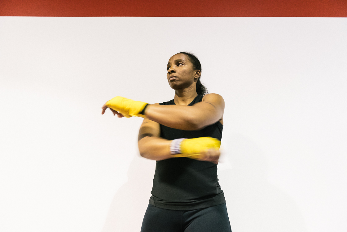Nelson warms up her arms after donning her hand wraps at the beginning of practice.