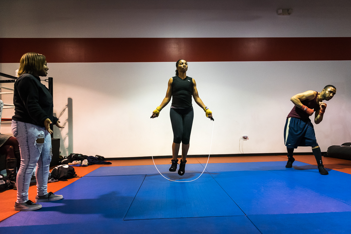"Nelson jumps rope as her daughter Simone Barnes watches from the sidelines. Many female boxers are encouraged to dress provocatively and in full faces of make-up for fights, but Nelson says, ""No, Lord, I'm a Christian, I'm a mom. I can't do that. If my talent don't sell it, I'm sorry."""