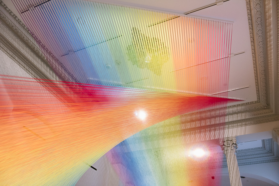 """Gabriel Dawe's rainbow installation is made of thousands of individual threads, giving new interpretation to the old adage, """"You can't see the forest for the trees""""."""