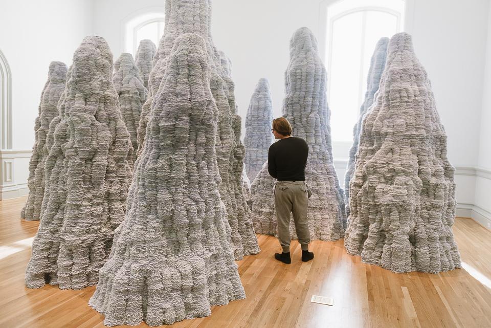Martin stands among Tara Donovan's installation made of index cards.