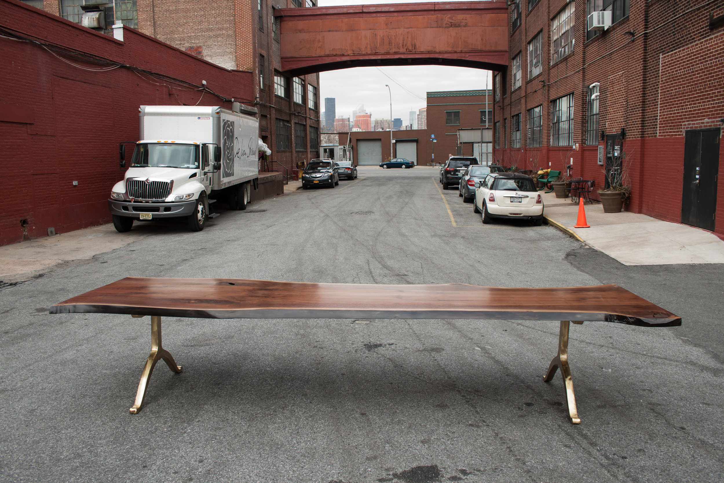 SENTIENT Large American Black Walnut Slab Dining Table with brass wishbone legs