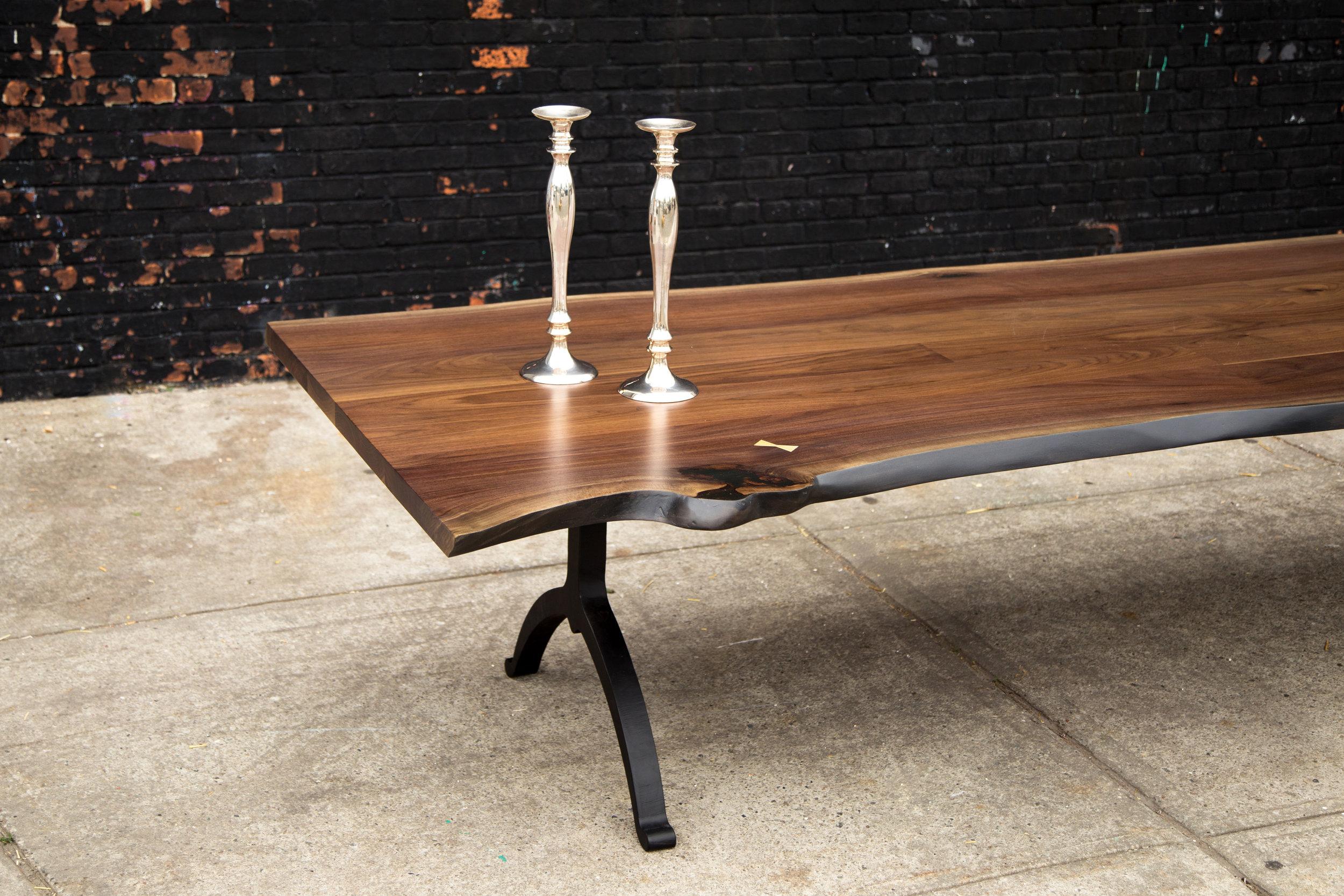 Live edge table with blackened steel legs