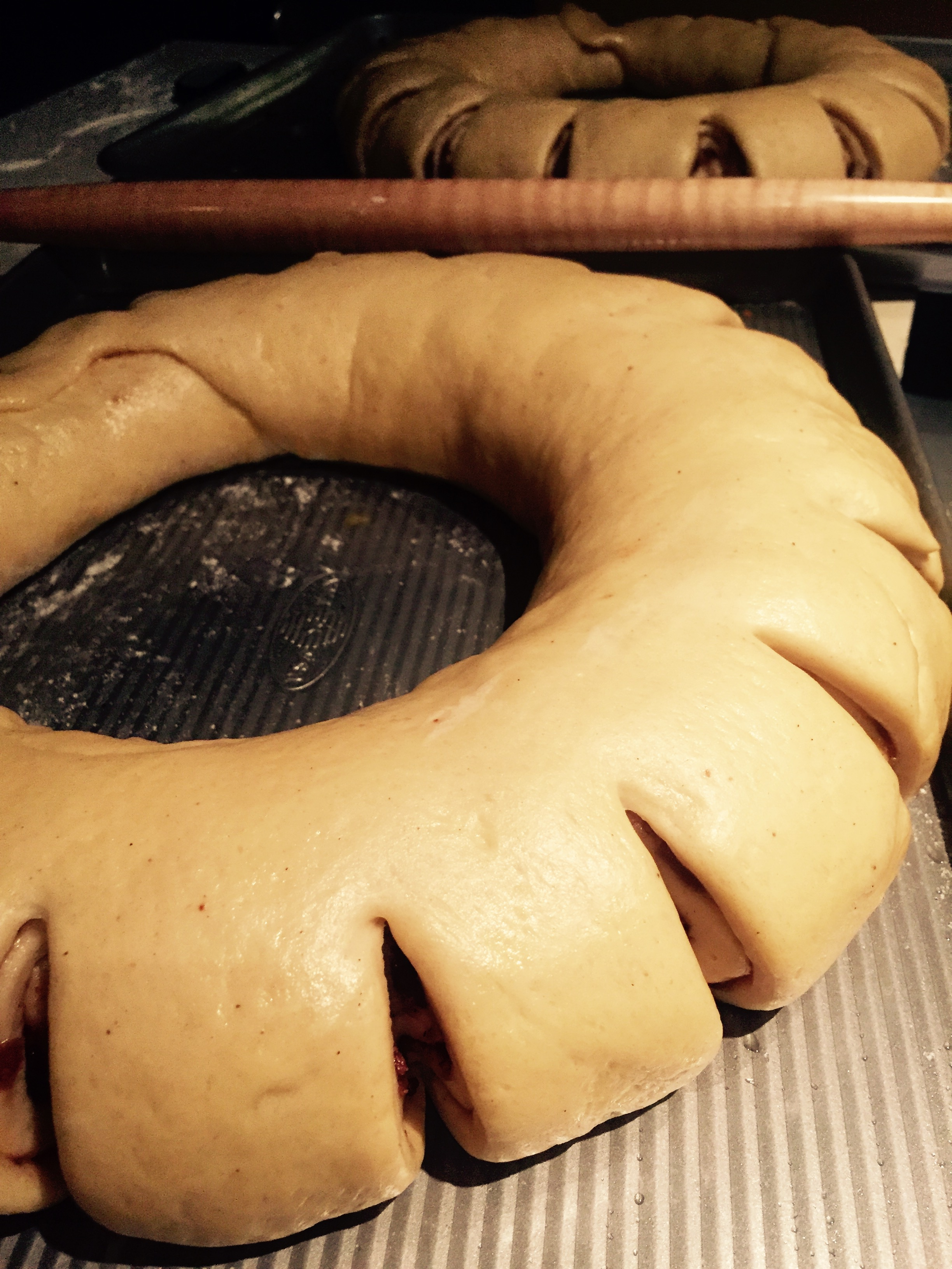 "I made cuts with kitchen scissors to give more of a ""crown"" look. King cake on the rise before baking!"