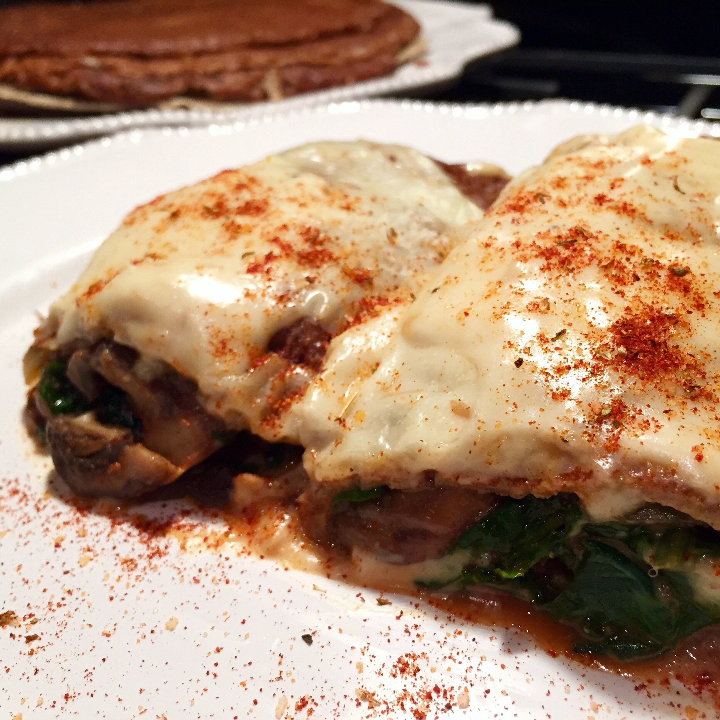 Buckwheat Crêpes Stuffed with Chicken Spinach and Mushroom, finished with a Smoked Gruyère Cream Sauce