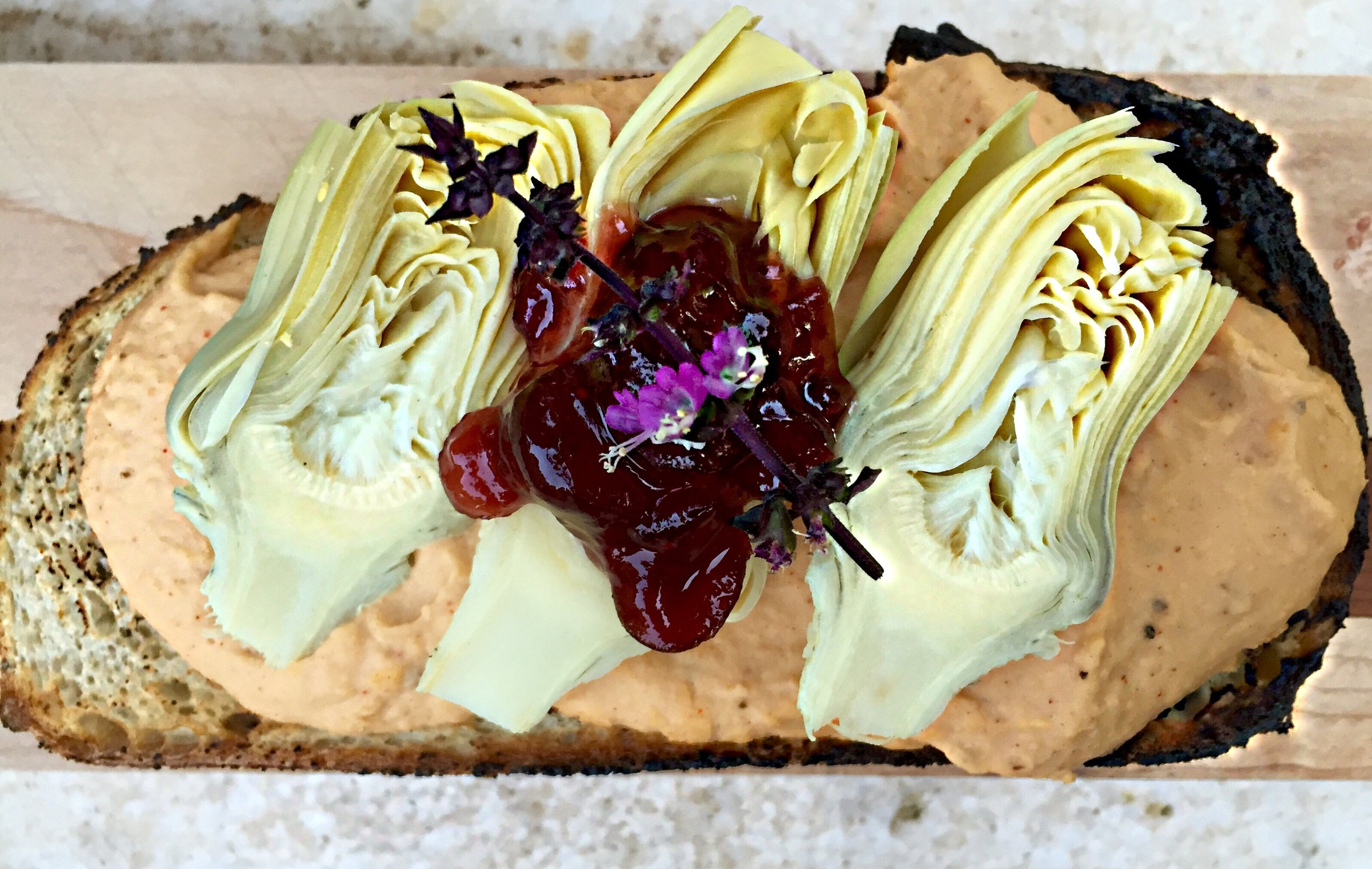 My Cannellini Bean Hummus on toast with artichoke hearts and  Cranberry-Fennel Compote