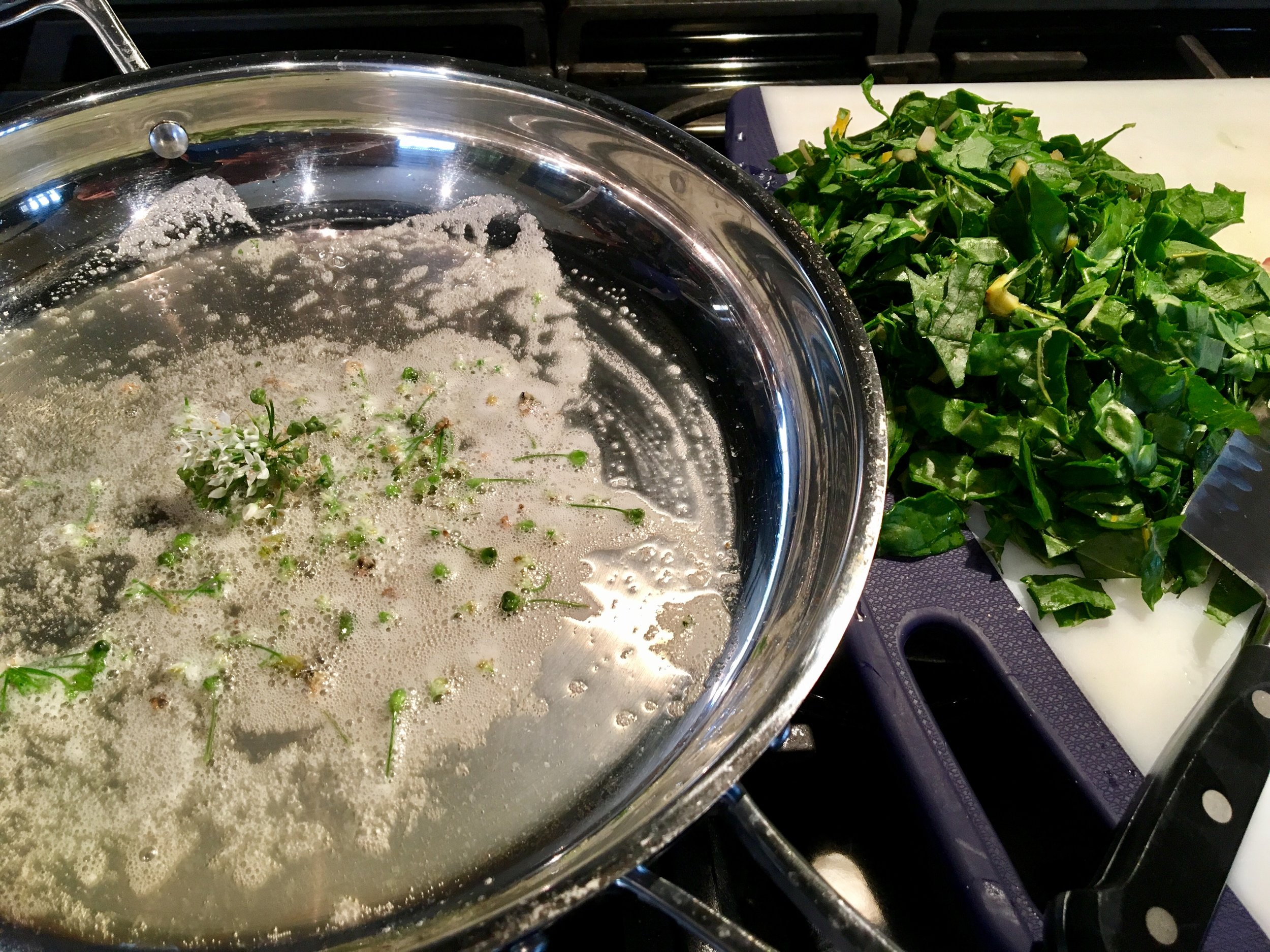 warming the garlic-chive buds and ready to cook the swiss chard.
