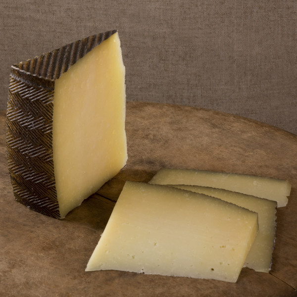 firm, rich, not too salty, spanish Manchego cheese