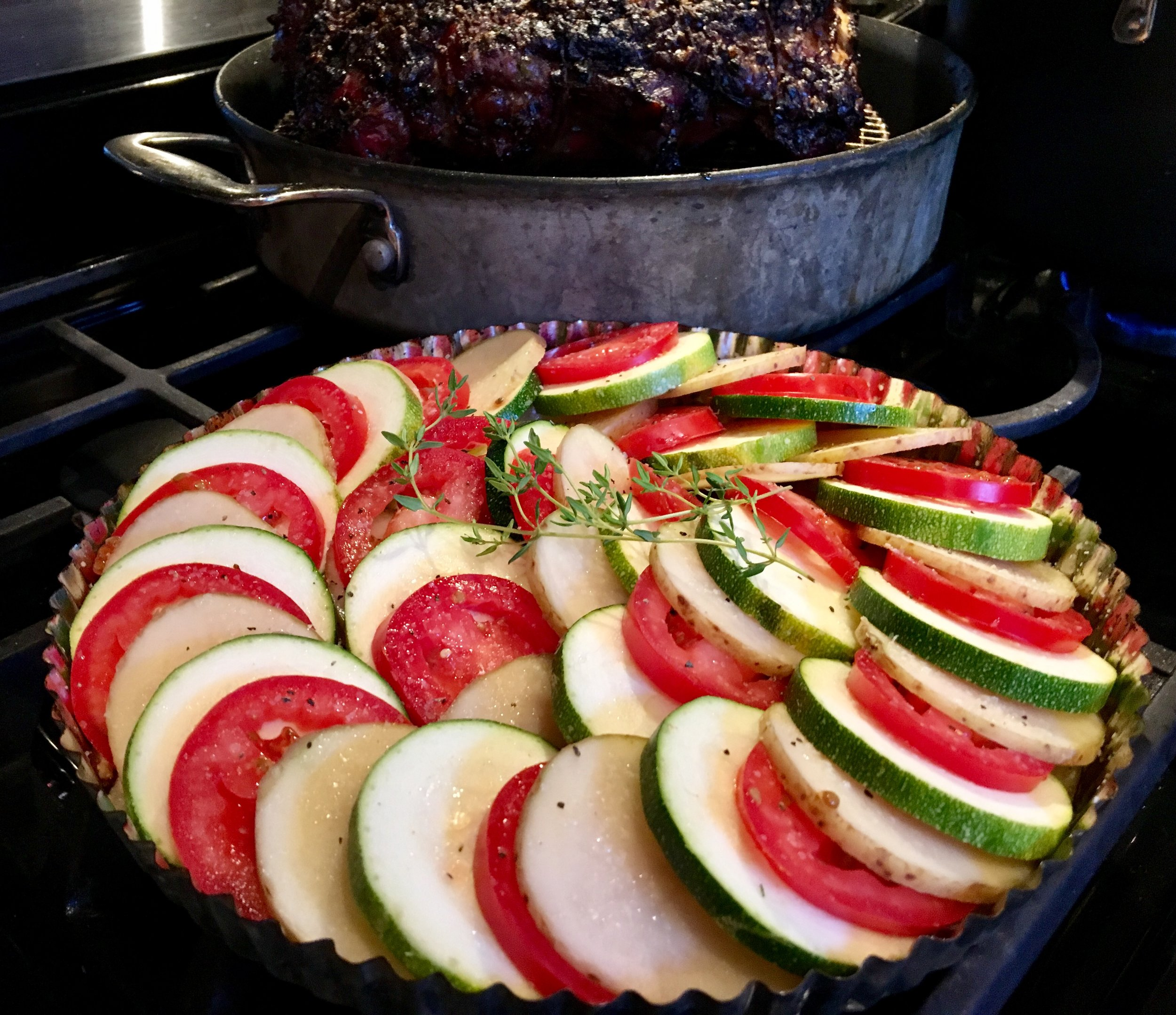 Tian almost ready for the oven, as the Roasted Prime Rib rests before slicing!